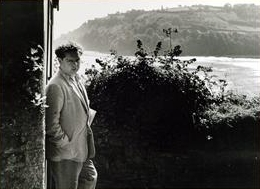 Dylan Thomas in Laugharne with Sir Johns hill in the distance